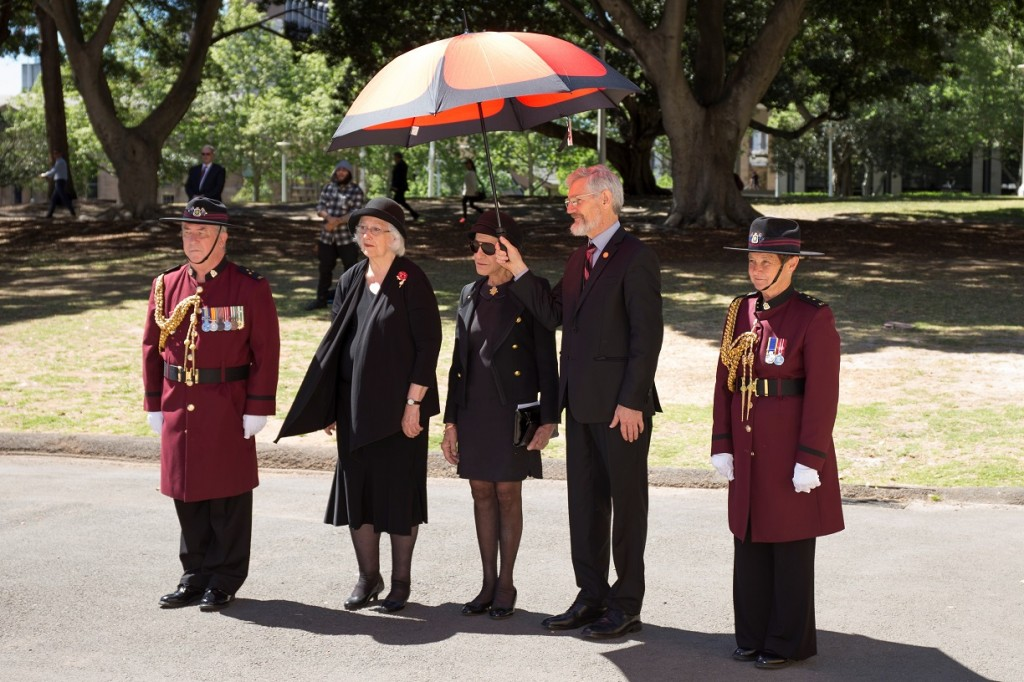 ANZ_YPRES_2017_047c Officials -Margaret Snodgrass, Dame Marie Bashir, Jim Munro with Poppy umbrella and Corps of Guards Iain Finlay & Pam Richardson